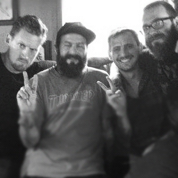 One of my favorite days. Drinking and tattooing in a woodshed. Miss these guys… (Taken with  Instagram )