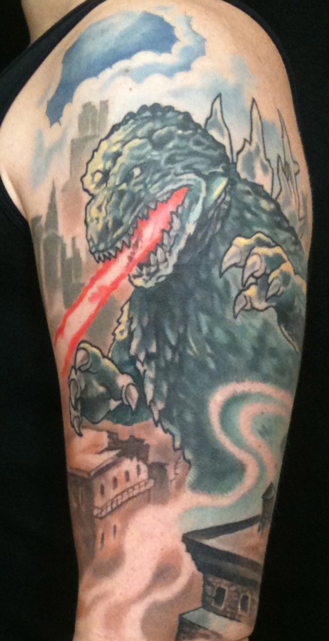 Old what's her name came by to let me get pictures of the healed godzilla tattoo.  I'm really happy with the way this one turned out.