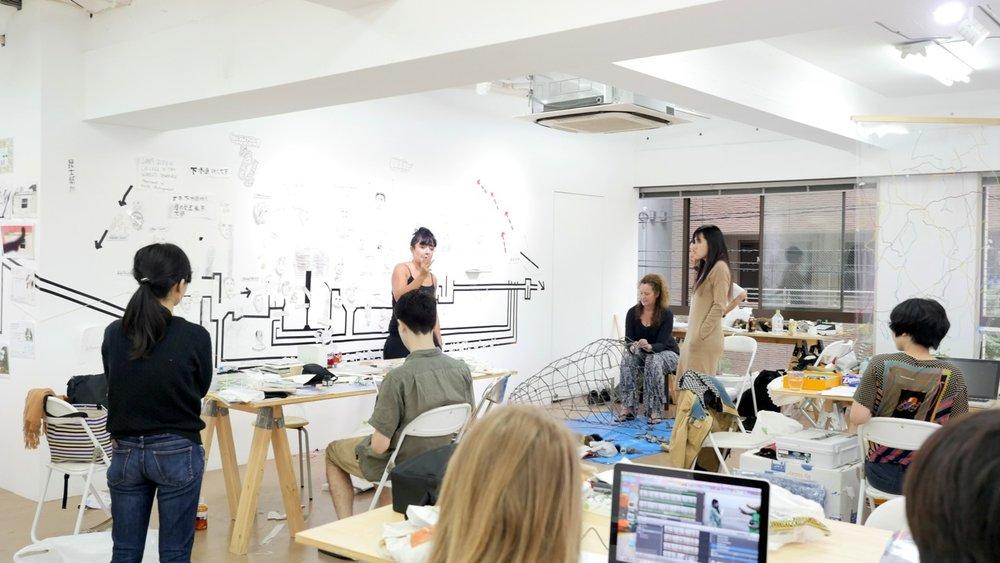 Professor Pat Hoffie addressing teams working in the 3331 Arts Chiyoda Nishikicho studio.