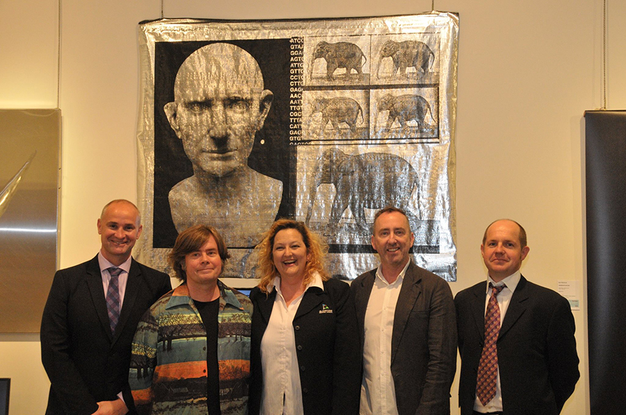 (From left to right in front of the winning entry) L-R Glenn Butcher, M.P; Blair Coffey, Artist; Jo Duke, Curator, Gladstone Regional Art Gallery and Museum; 2016 Judge Jason Smith; Peter Harrington, Acting General Manager, Rio Tinto. Photographer K. Price.