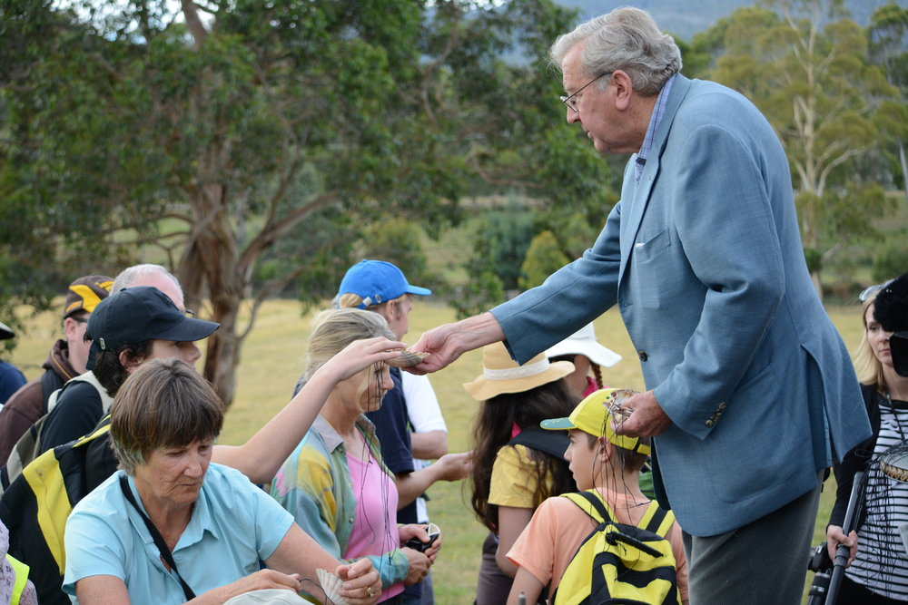 Way to St James_Fr Michael Tate handing out shells_1.JPG