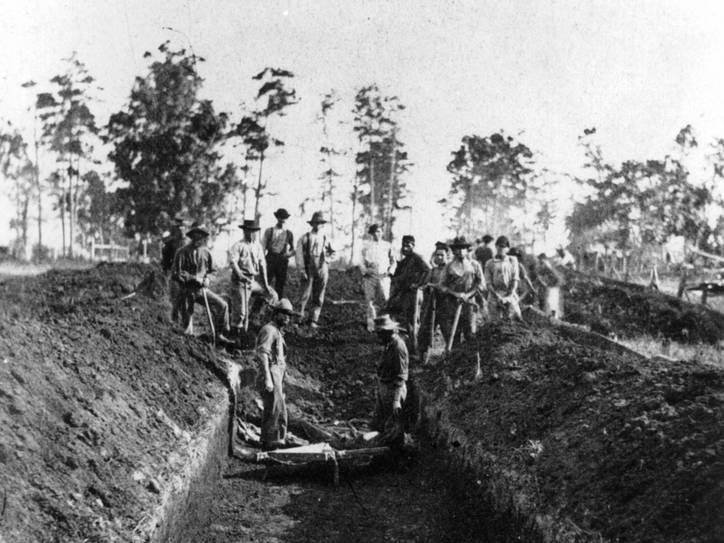 Burial Detail at Andersonville, a Confederate prison for Union soldiers, August 1864. In the 1860s, a 'dead line' was a line within or around a prison. Prisoners would be shot for crossing the 'dead line'.