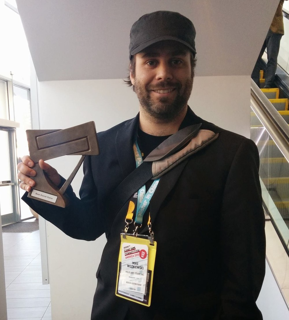 Mike shows GameConnection award for Best Social Game