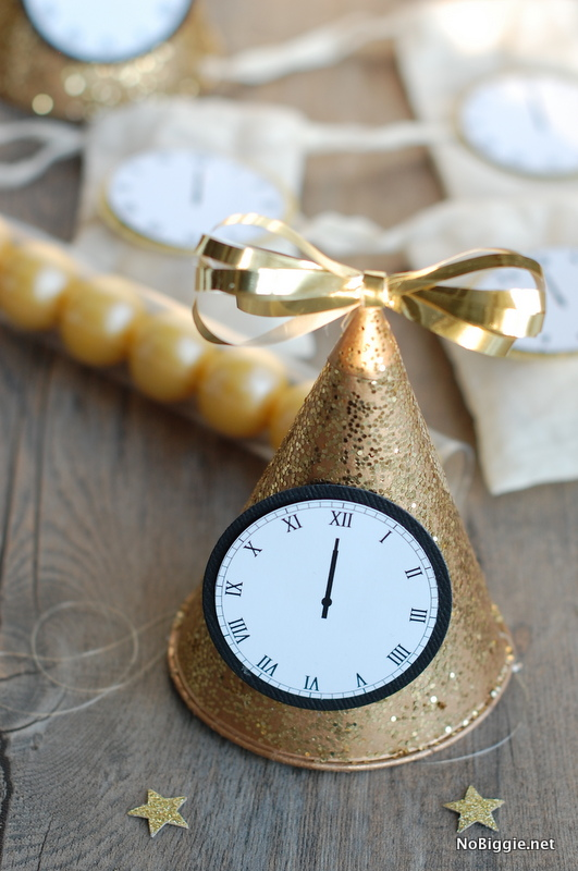 party-hats-to-Celebrate-New-Years-Eve-with-this-free-printable-midnight-clocks-via-NoBiggie.net_