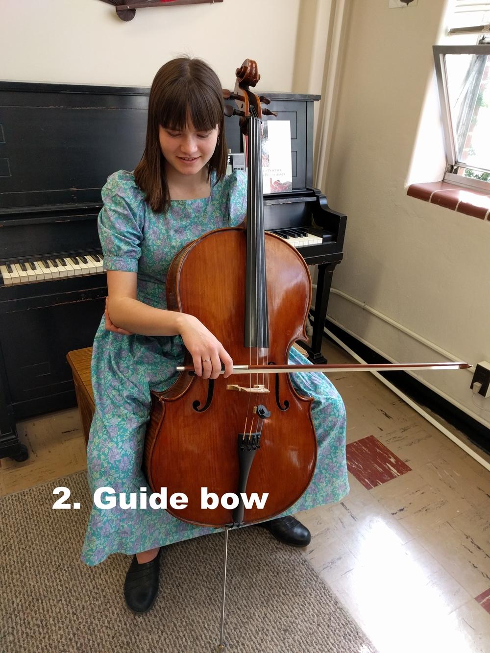 7. guide bow onto string.jpg