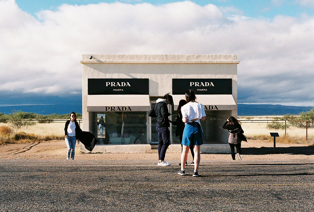 Tourists creating a pop up photoshoot at the Prada Marfa, Texas.