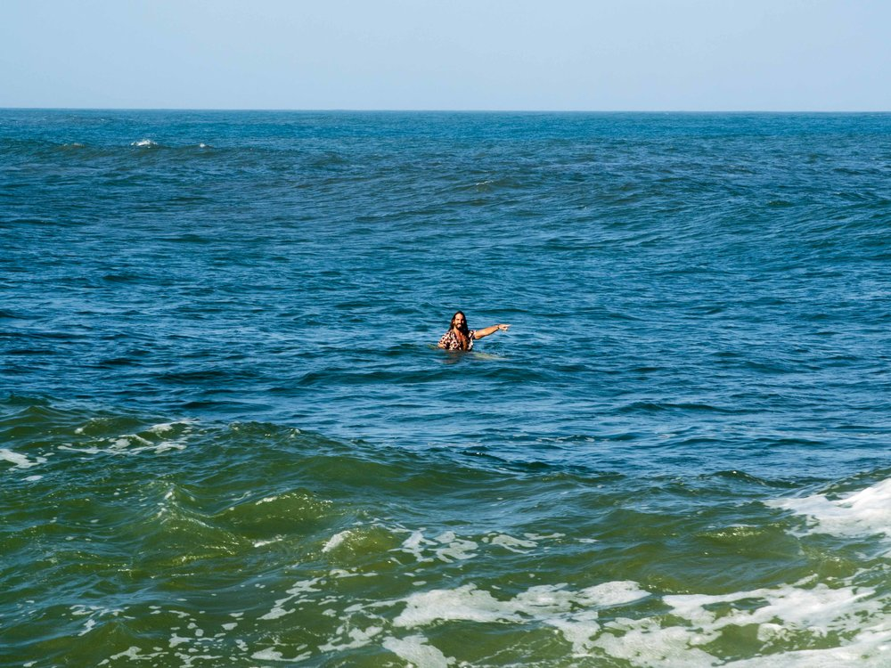 The East Coast may be the only place it's ok to surf in floral, the author showing how. Credit: Katie Beard.