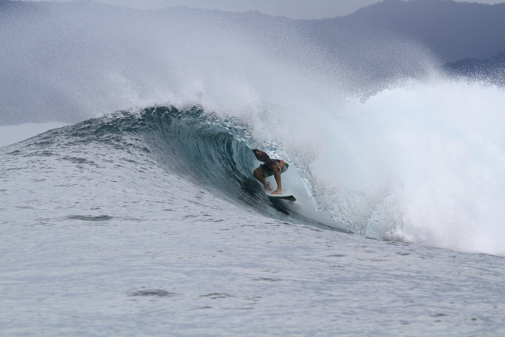 Aftanas Surfboards' team members catching a barrel.