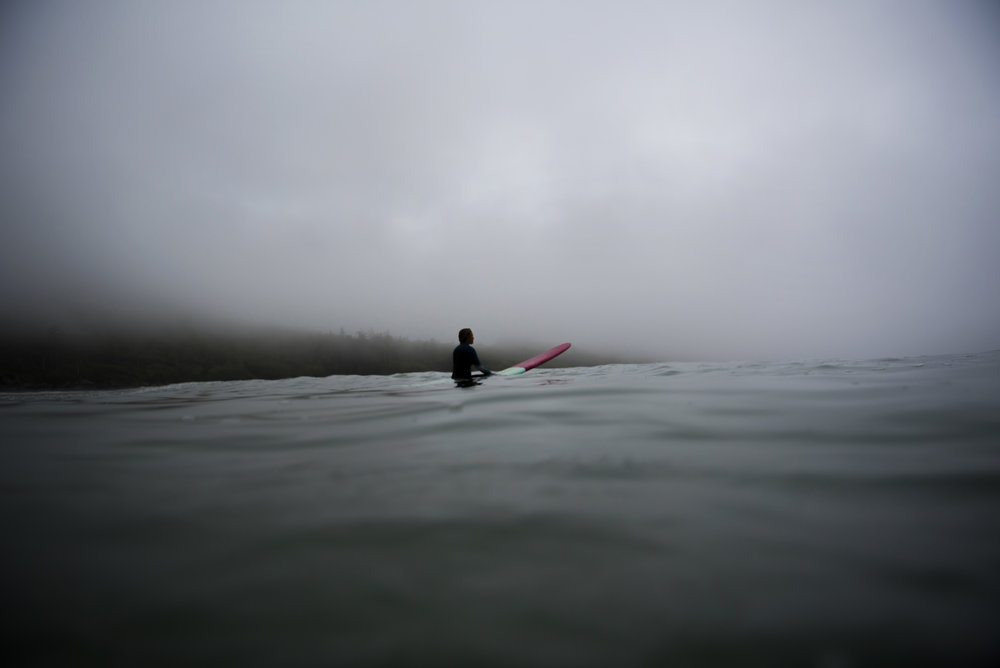Lydia Ricard waiting for the perfect wave in Tofino, BC. Credit: Bryanna Bradley