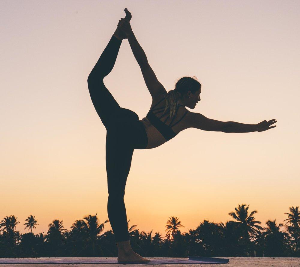 Yoga at sunset in Sri Lanka. Photographer: Christian Quinlan