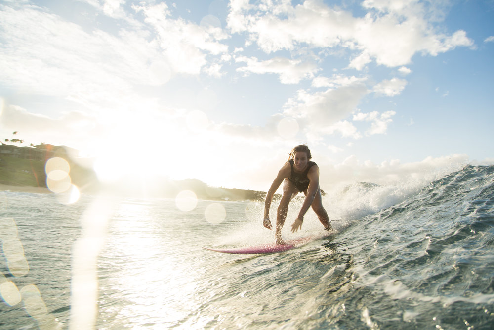 Bianca Buitendag is also charging the rest of the time. Here she is in Maui, enjoying a sunset ride. Shot by Tim Kothlow