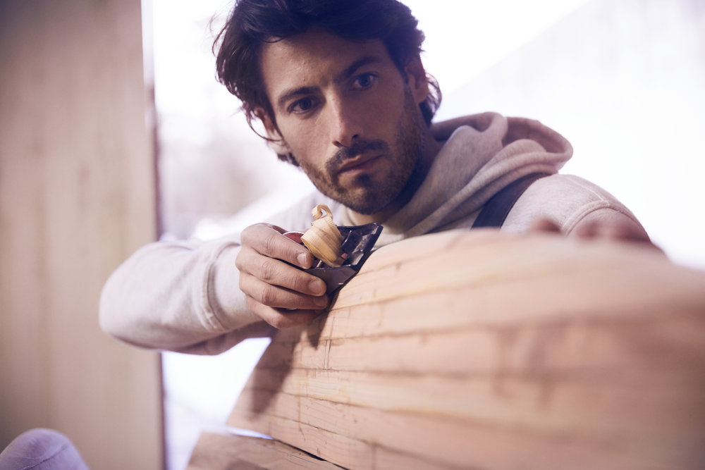 João Pedro Carvalho, founder of Oak Surfboards, currently working on his next wooden board.