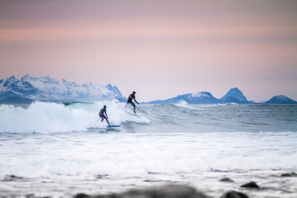 Friends that surf together, stay together. Lofoten, Norway. Photo by Jakob Gjerluff