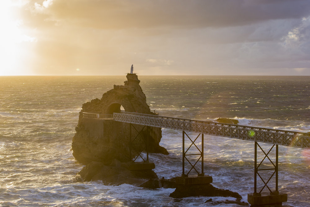 The view of a pier in Biarritz, France, with an incredible sunset. Photo by Florian Gruet