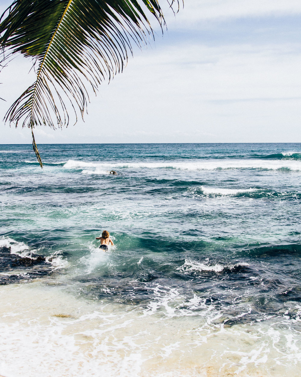 Time to paddle in crystalline water in Sri Lanka. Photo by Morgan Woods & Christian Quinlan