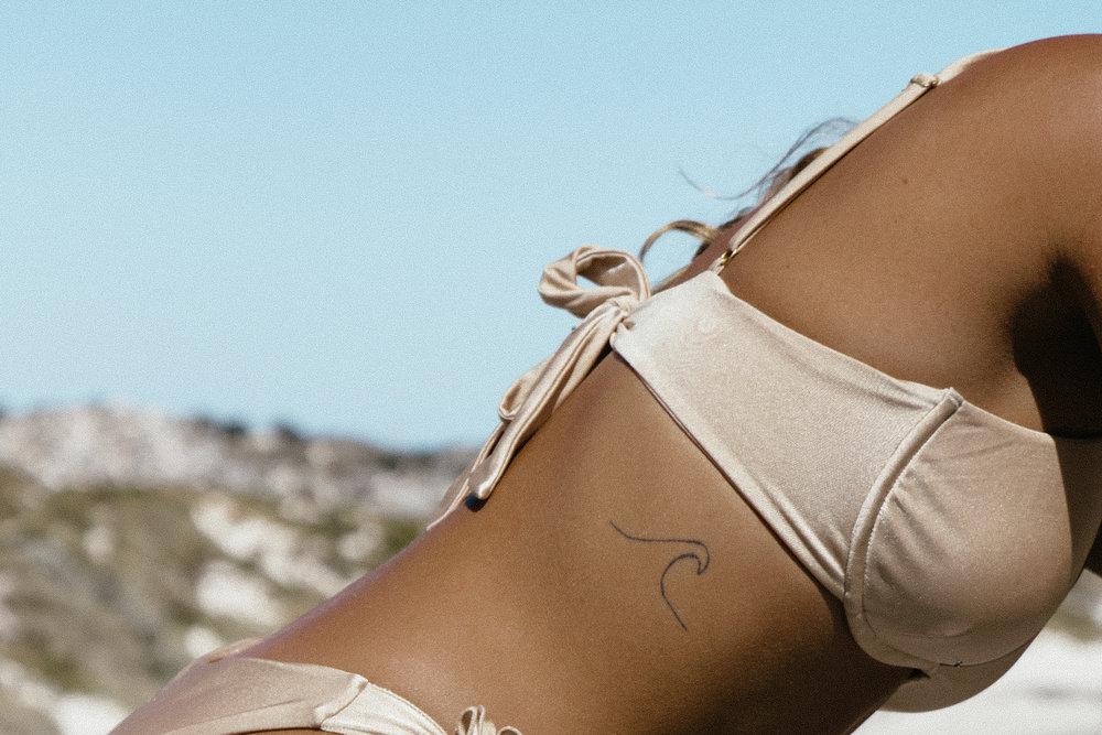 Matilda Djerf wearing the Angelica Bikini Top in gold from Ete Swimwear. Photo: Matilda Djerf
