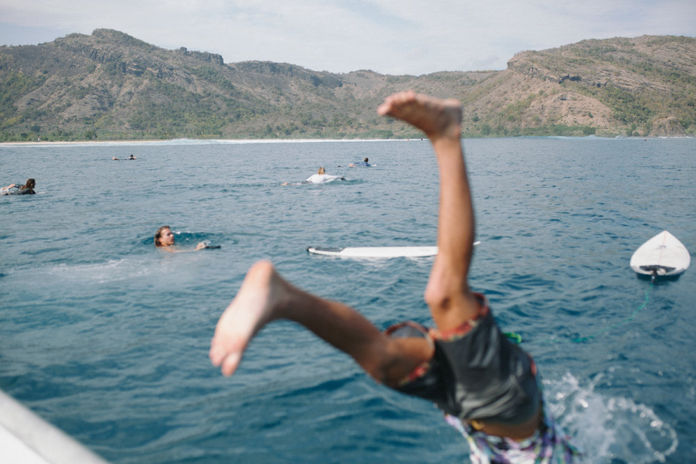 Jumping off the boat to go catch some waves! Sumbawa, Indonesia. Photo by Ellen Mary Taylor