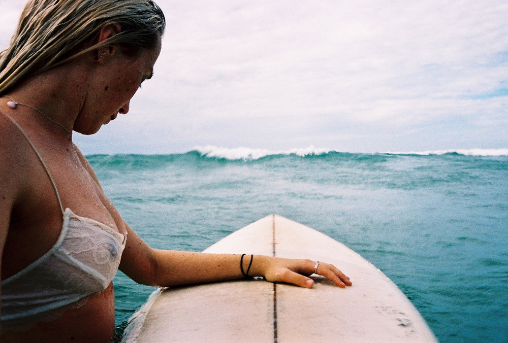 Zoe Boxshall going in for a surf. Byron Bay, Gold Coast, Australia. Photo by Rachel Frankenbach