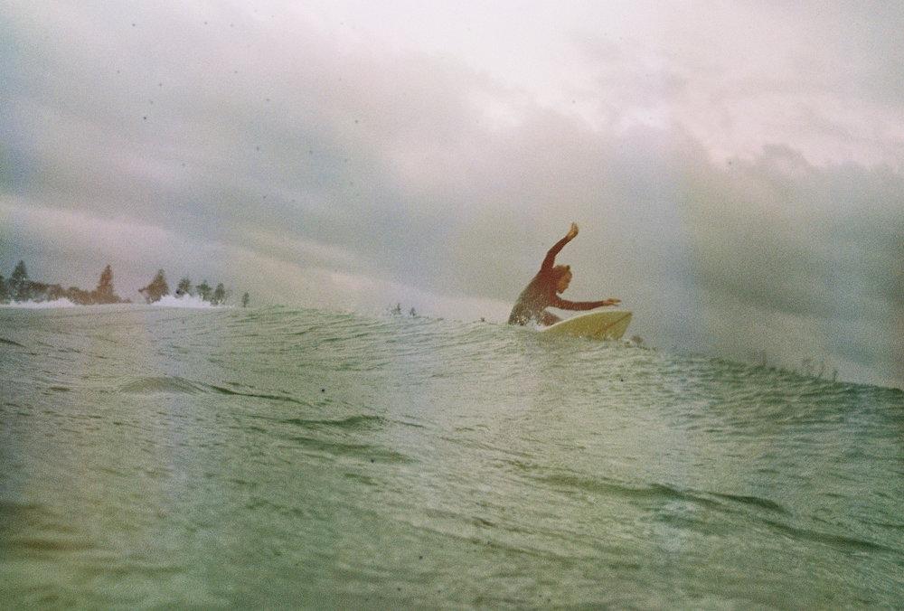 A surfer in Byron Bay, Australia. Photography by Rachel Frankenbach