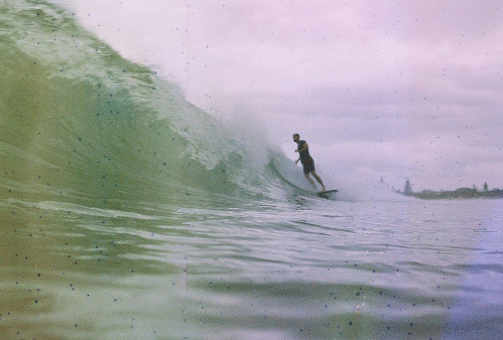 A surfer in Byron Bay, Gold Coast, Australia captured with a film camera. By Rachel Frankenbach