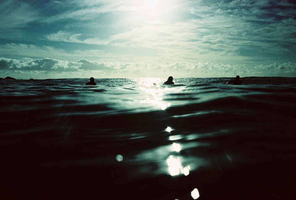Pavman Paradiso and other surfers waiting in the lineup. Photography by Rachel Frankenbach
