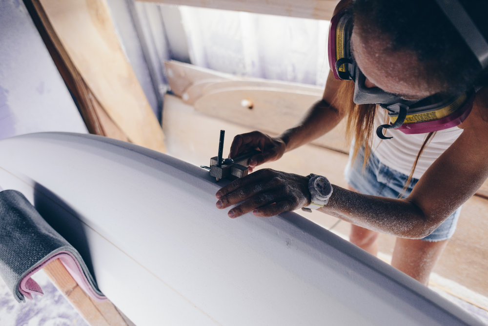 Valerie of Mere-Made Surfboards shaping in Encinitas, California. Photo by Austin Mullen