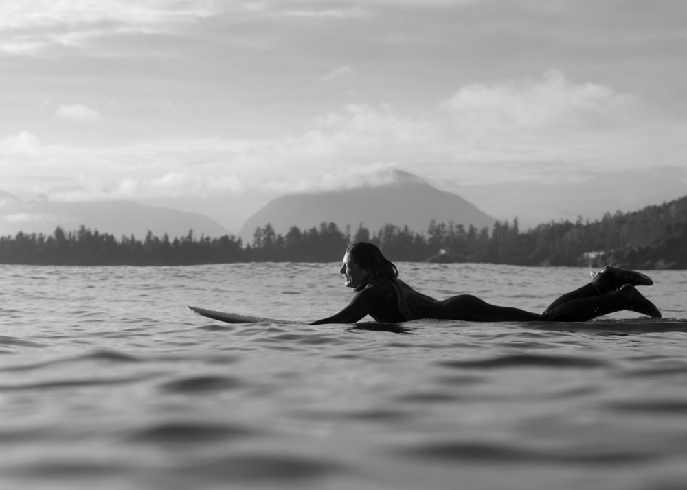 The joy of cold water surfing with Emily Grubb. Tofino, BC. Credit: Bryanna Bradley