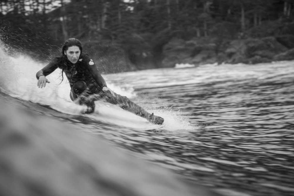 A surfer shredding the waves in the cold water of Canada. Photo by Bryanna Bradley