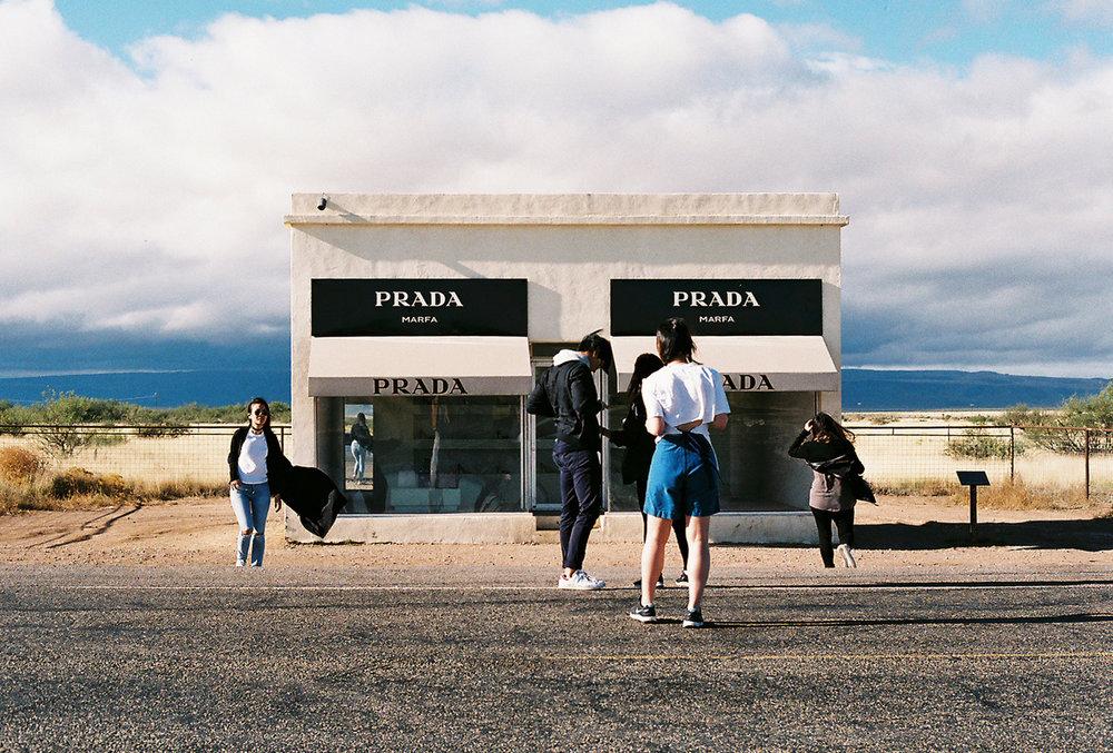 Tourists creating a pop up photoshoot at the Prada Marfa, Texas