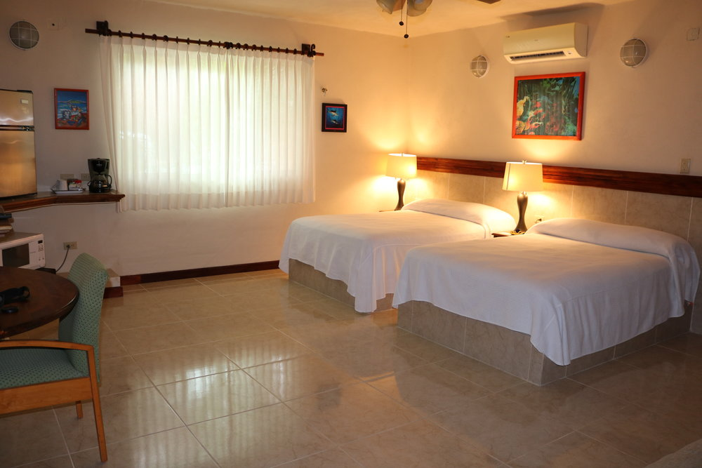 Garden Villa - Double Room / Garden ViewsTwo Double Beds + Sofa BedPrivate BathroomMini Fridge, Coffee Maker & MicrowaveTV, AC + WIFI