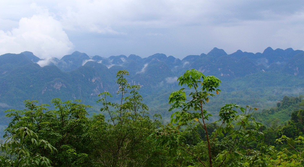 A view across the valley near Silantai, karst formations rising out of the remote valley