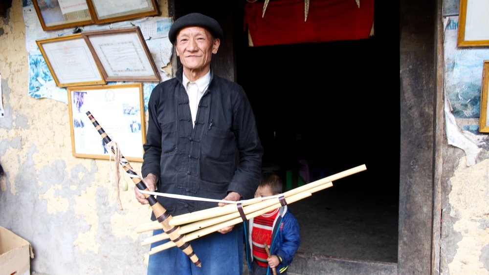 A Hmong man and his qeej mouth organ in Ha Giang, Vietnam.