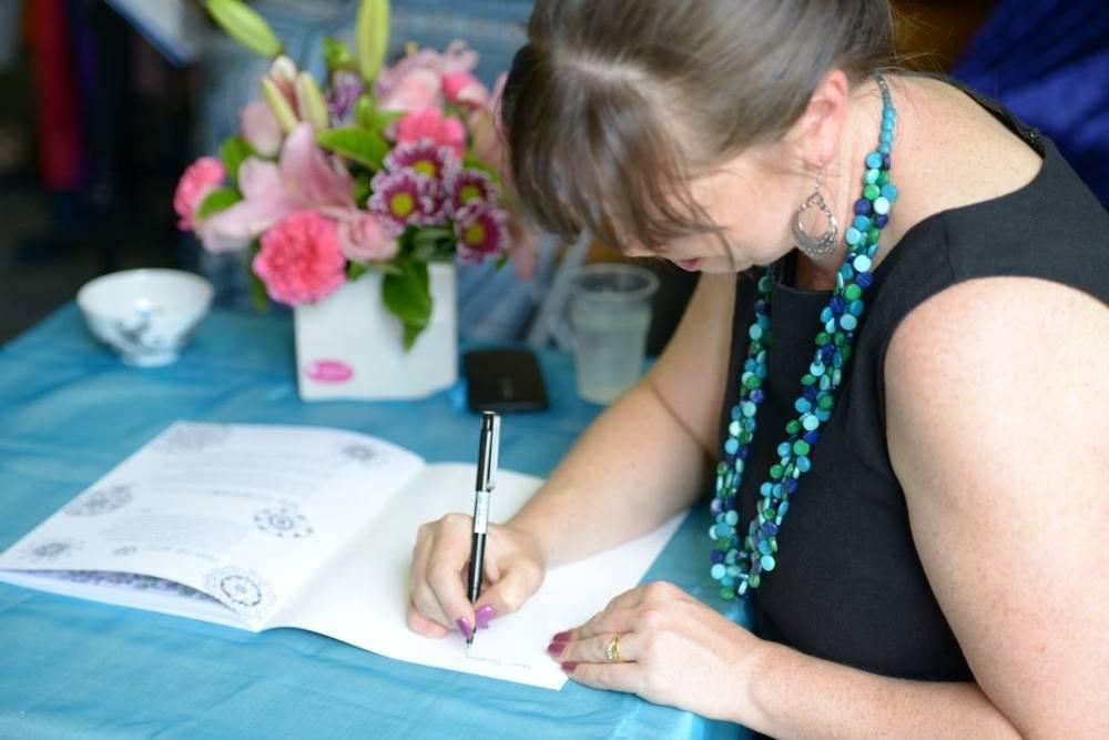Lorien Atwood signs books. Photo by Rachel Li