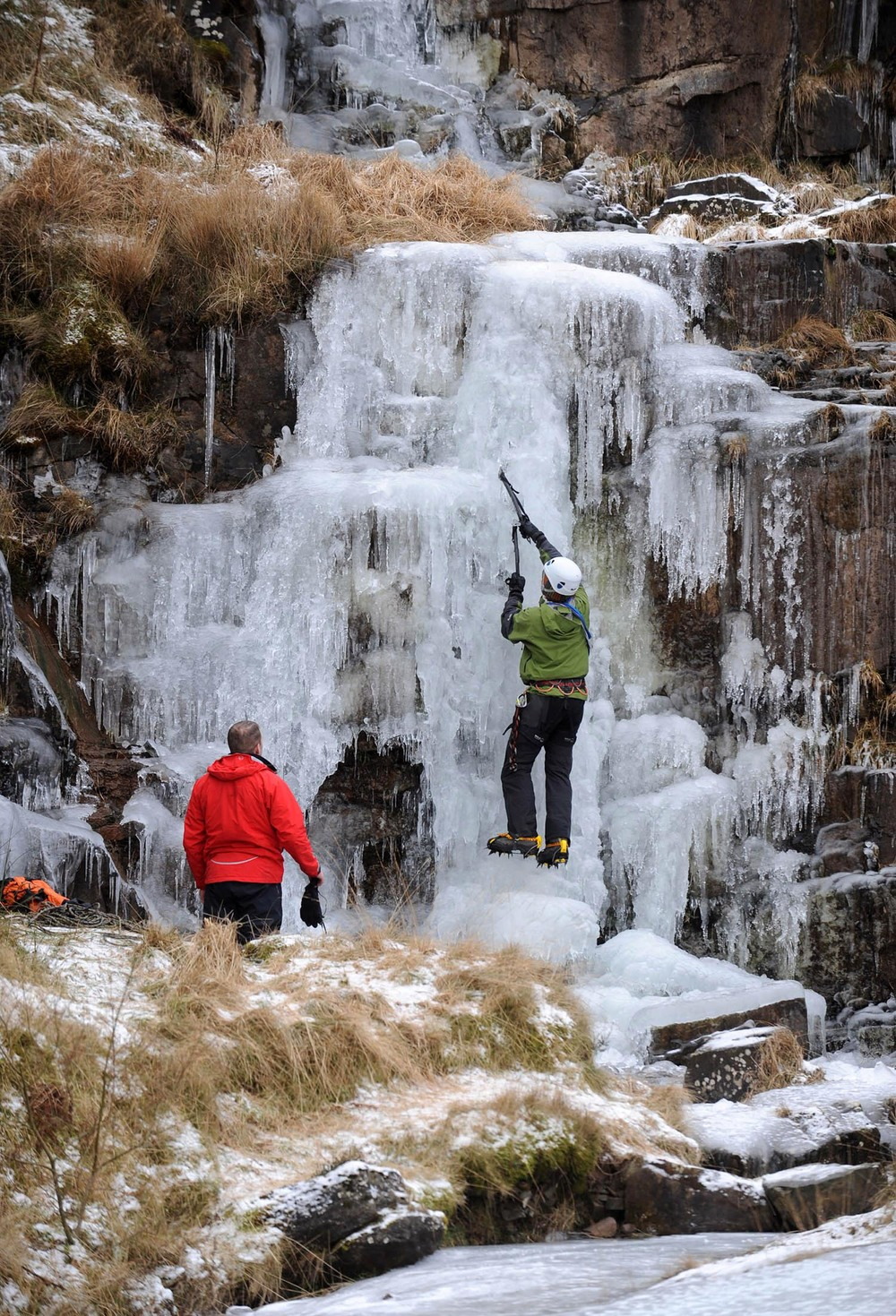 Climbers try to climb a frozen waterfall near Brecon