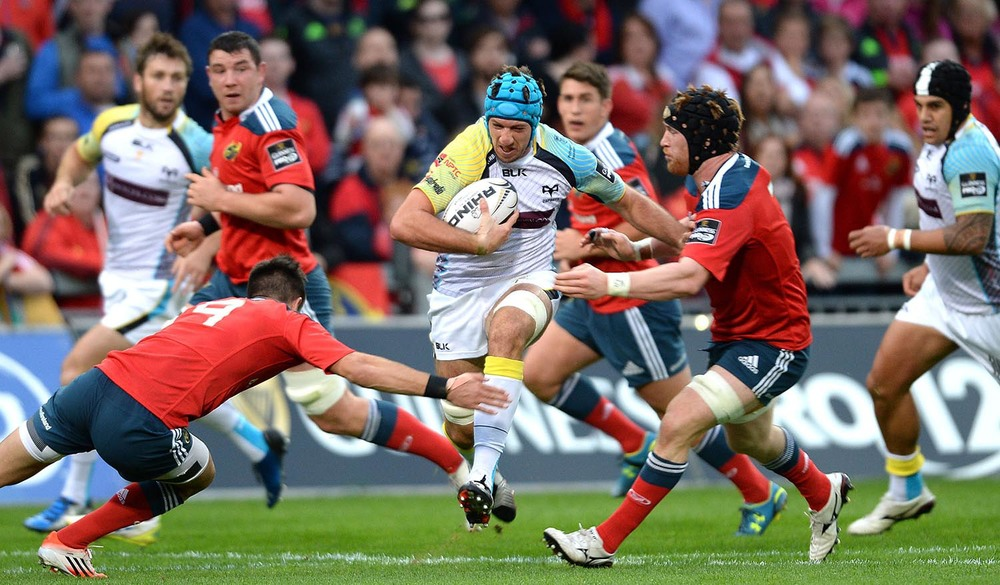 Justin Tipuric of Ospreys is tackled by Conor Murray and Sean Dougall of Munster