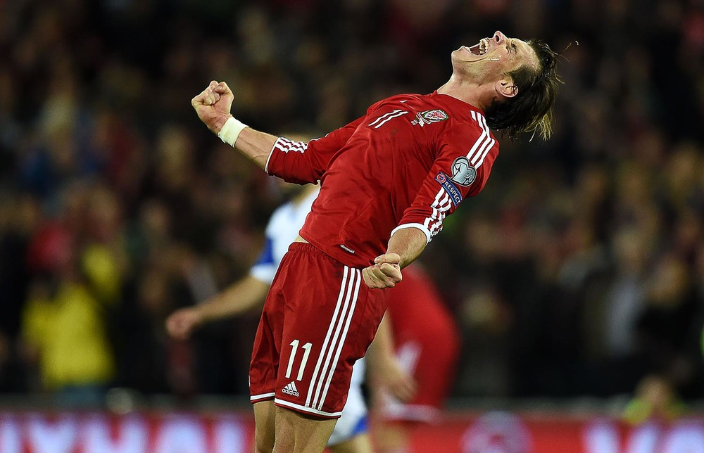 Gareth Bale celebrates a Wales victory at full time
