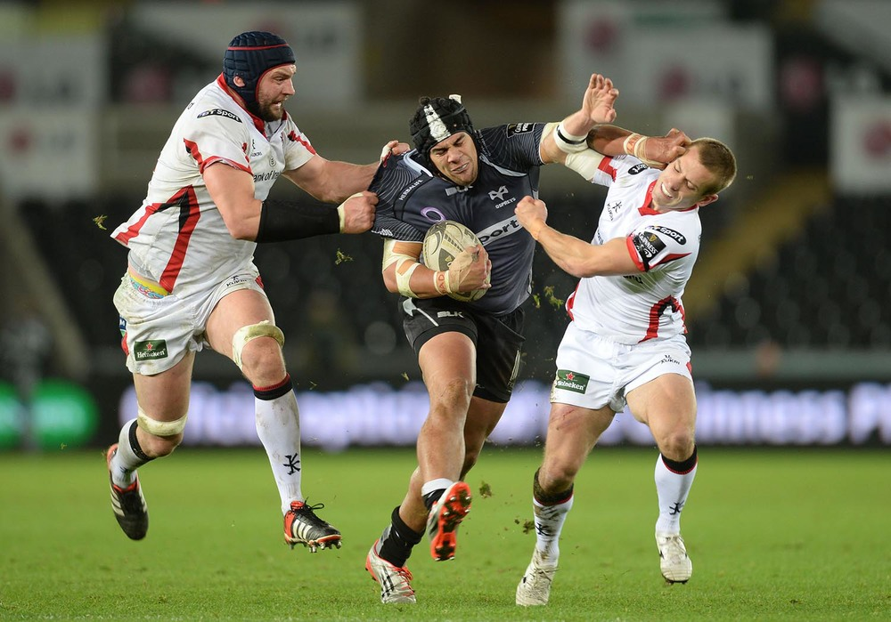 Josh Matavesi of Ospreys is tackled by Dan Tuohy and Paul Marshall of Ulster