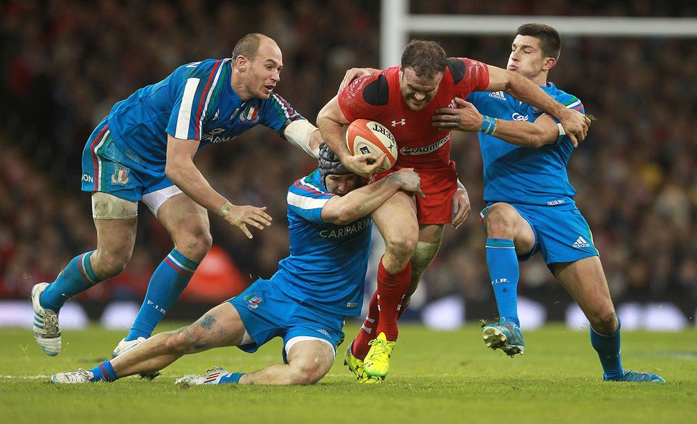 Jamie Roberts of Wales battles past the Italy defence