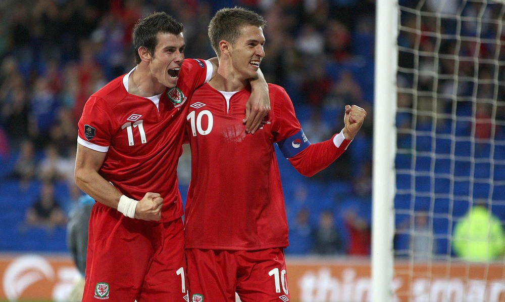 Wales' Aaron Ramsey celebrates with Gareth Bale after scoring