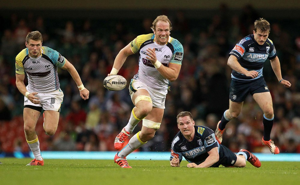 Alun Wyn Jones of Ospreys powers past Gethin Jenkins of Cardiff Blues