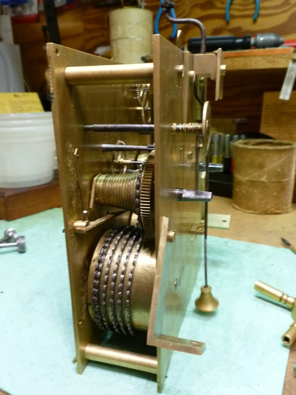 In this picture you can see the pendulum and winding arbors. This clock you wind from the back.