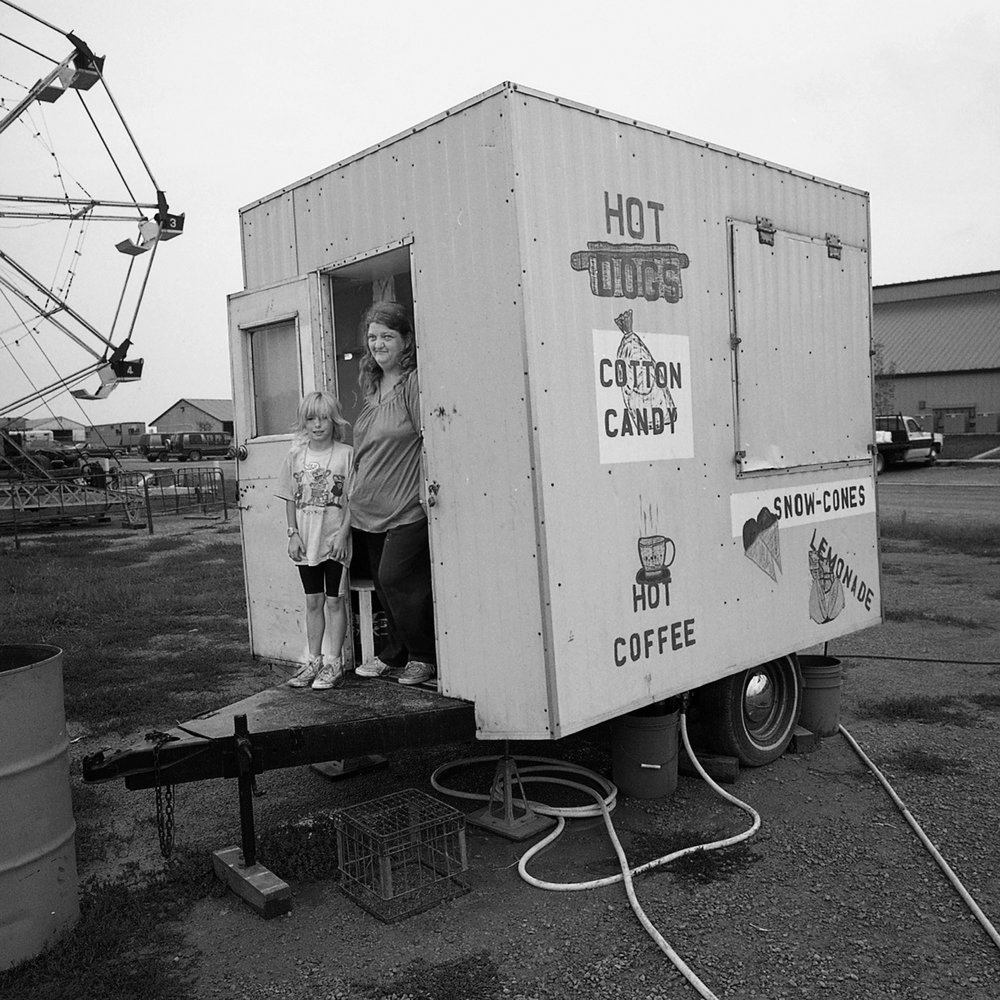 Mother and Daughter in the Cotton Candy Truck, Eureka, Kansas, archival pigment print, 16x20, 1990