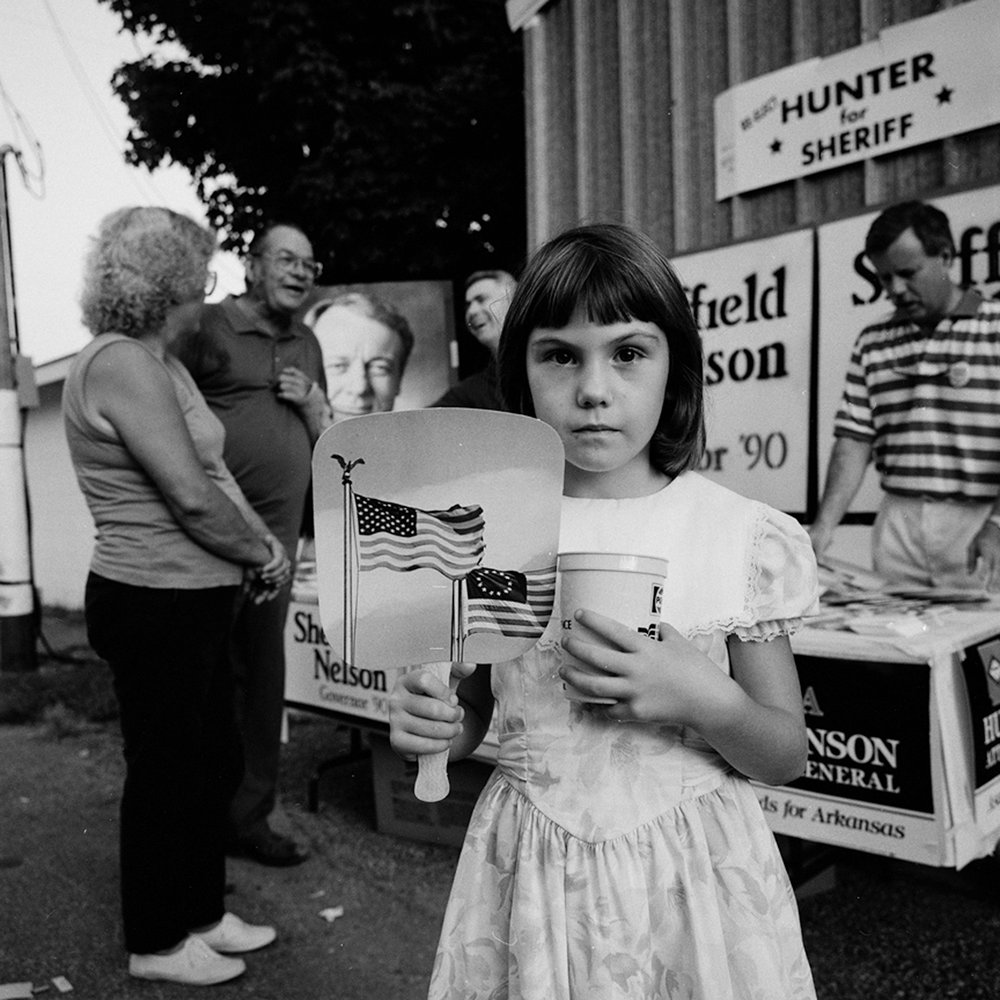 Girl with Flag Fan, Batesville, Arkansas, archival pigment print, 16x20, 1991
