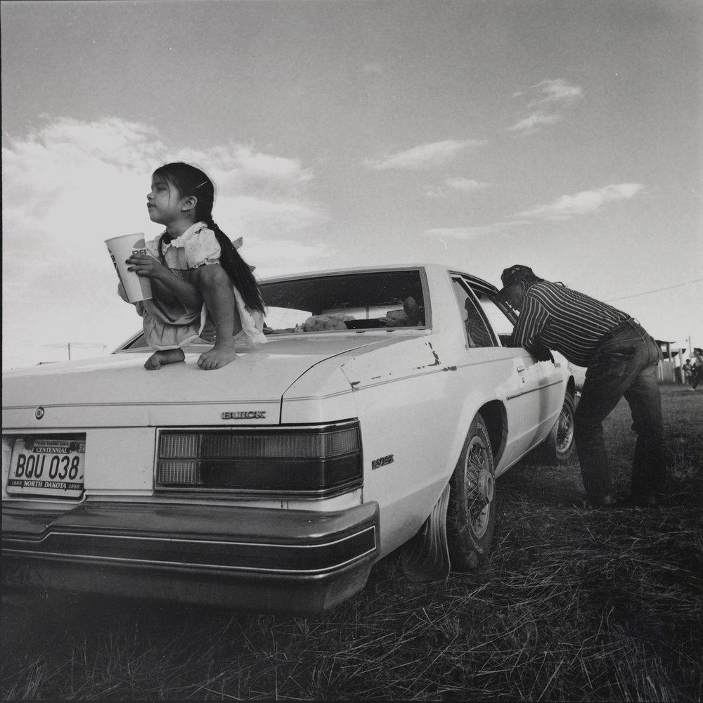 Girl on Car at Pow Wow, Mandaree, NorthDakota, archival pigment print,16x20, 1990