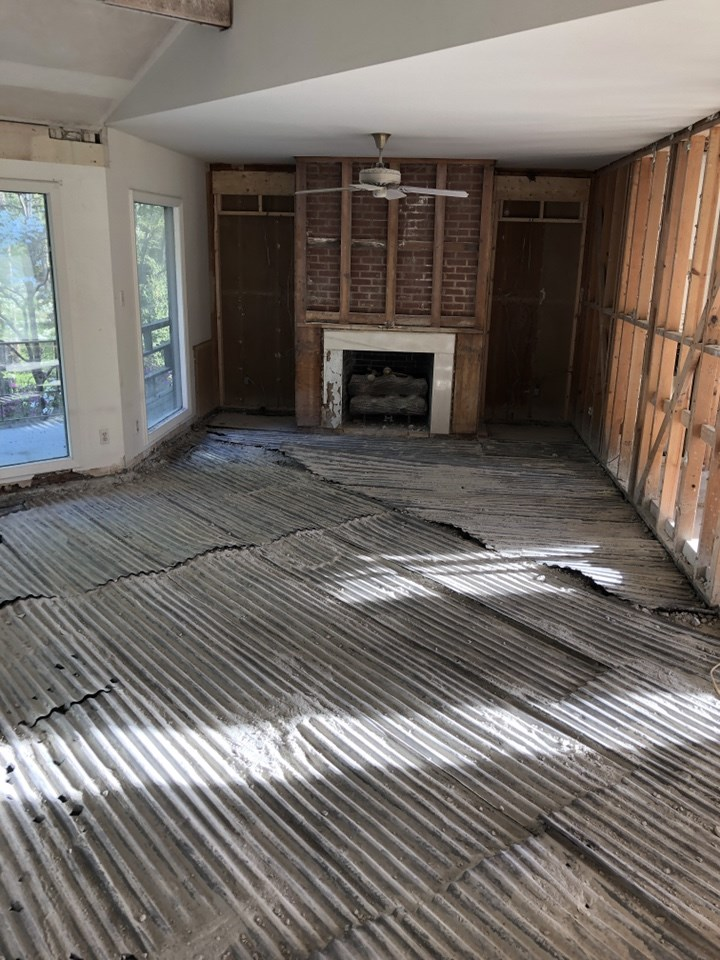 The original concrete floor had to be scrapped and prepped in order to make it level with the adjacent floor. New hardwood flooring will be installed throughout.  The paneling has been removed in the basement. The walls are now being prepped for new sheetrock.