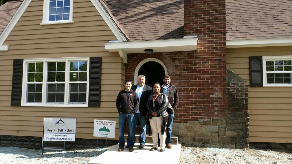 5201 S. Salina St., post-renovation, with developers and new homeowner, Lessie, Vice Principal at Fowler High School