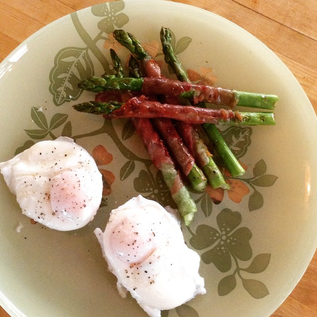 Finshed my #whole30 but still love me a #paleo brekkie! Poached eggs with pancetta wrapped asparagus soldiers