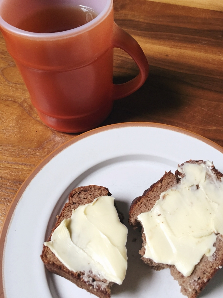 Breakfast of grain-free banana bread and hot tea to start the day off right.