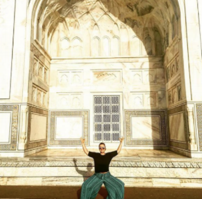 me, striking my best powerful goddess pose at the Taj Mahal in May 2017.