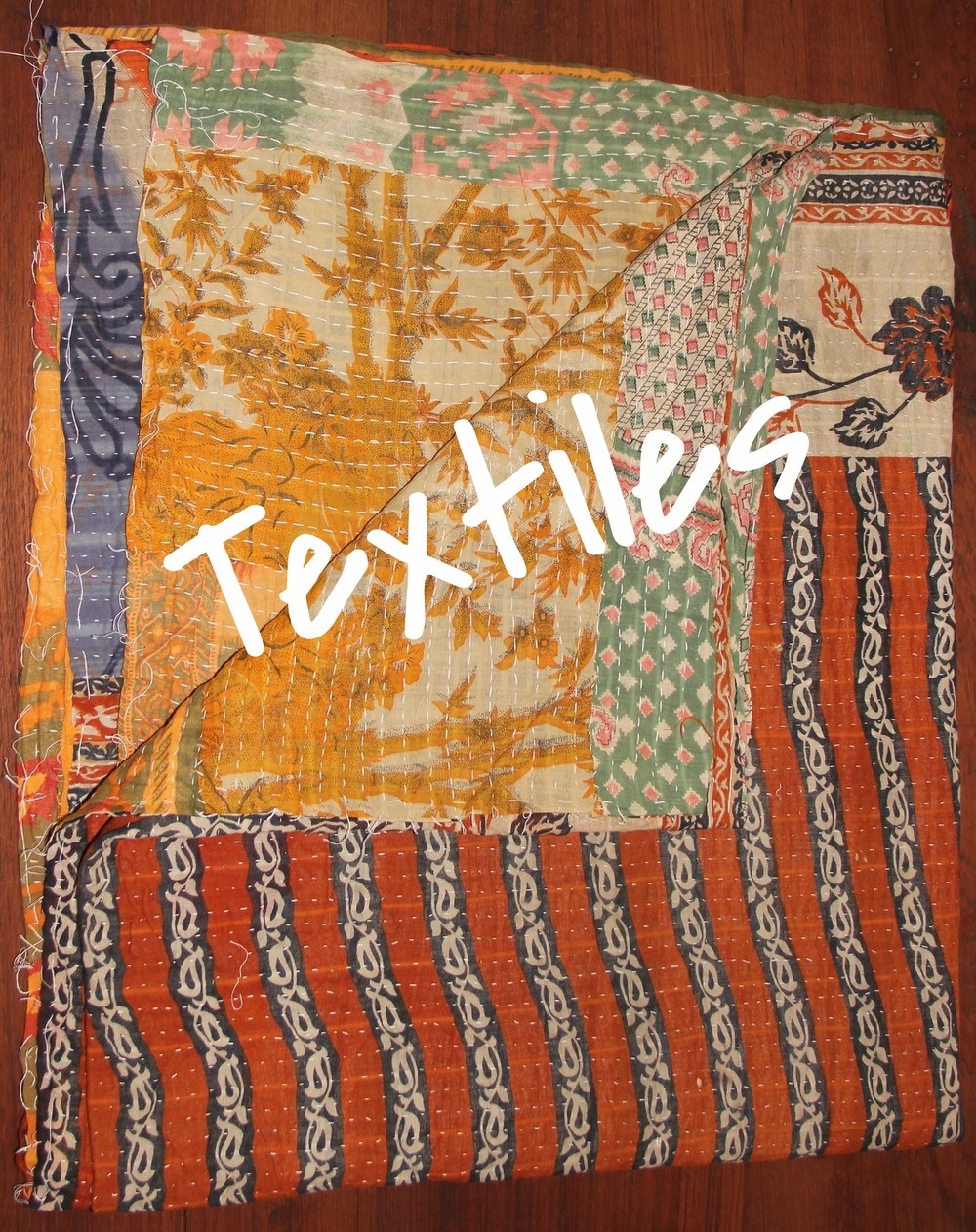 "Fair Trade Kantha Quilts from India in ""throw"" sizes of about 80""x 52"". Quilts are made from vintage cotton saris featuring beautiful block printing. Pillows also Fair Trade are from Thailand and feature hand woven fabric combined with printed fabric (on some). Pillow size is approximately 16""x16""."